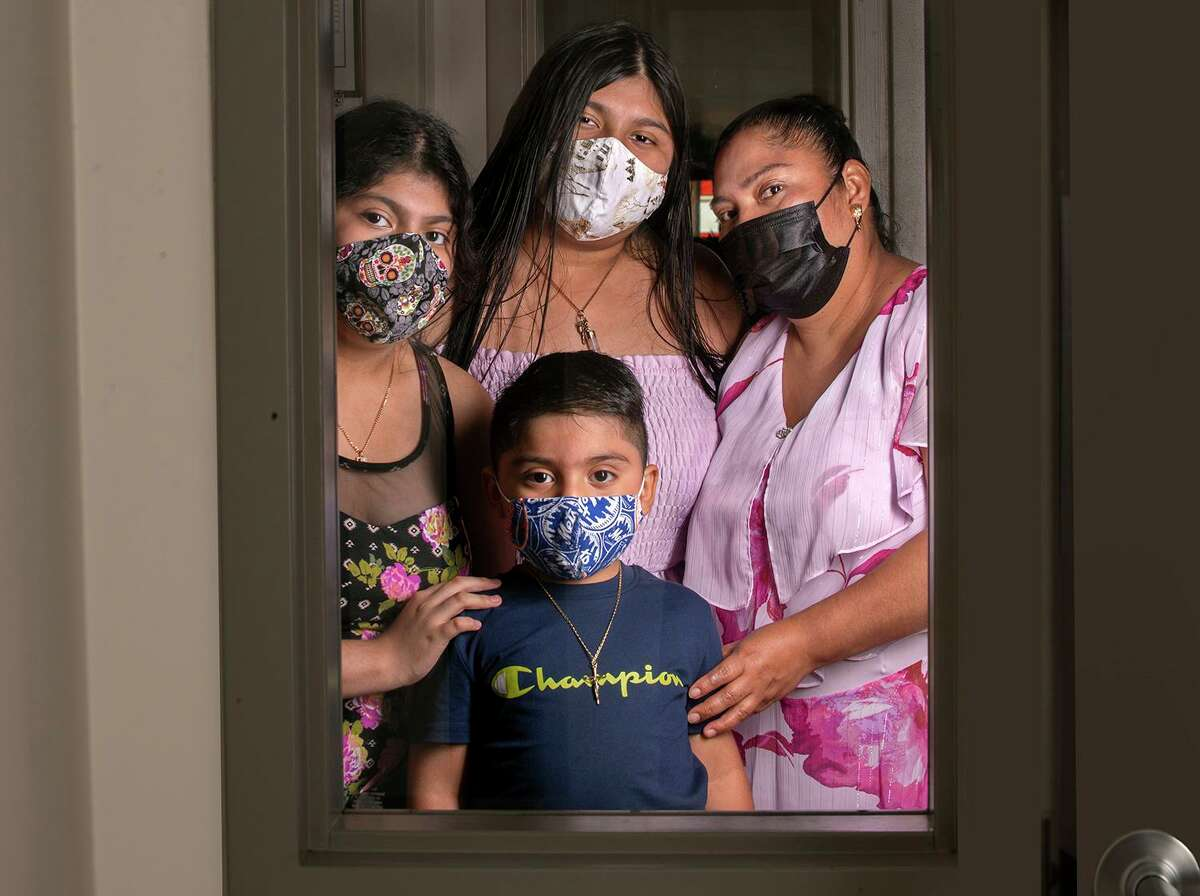 The Martinez-Nava family, clockwise from right, Angelina Martinez-Nava and her children Alesander, 4, Carolina, 12, and Arlene, 14.