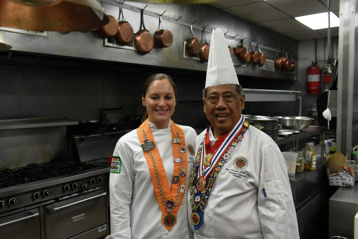 Chef Gabriella O'Neil, left, with her mentor, chef and restaurateur Yono Purnomo on Thursday, Sept. 9, 2021, in the kitchen at Yono's, dp An American Brasserie in Albany N.Y. O?•Neil a few months ago won the U.S competition for young chefs sponsored by the international culinary organization Chaine des Rotisseurs. In late September she will be the sole competitor representing the U.S. in a Chaine cook-off in Paris.