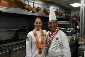 Chef Gabriella O'Neil, left, with her mentor, chef and restaurateur Yono Purnomo on Thursday, Sept. 9, 2021, in the kitchen at Yono's in Albany, N.Y. A few months ago O'Neil won the U.S. competition for young chefs sponsored by the international culinary organization Chaine des Rotisseurs. In late September she will be the sole competitor representing the U.S. in a Chaine cook-off in Paris.