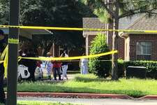 Authorities investigate a shooting that erupted after police were serving an arrest warrant at a complex in Harris County on Monday, Sept. 20, 2021.