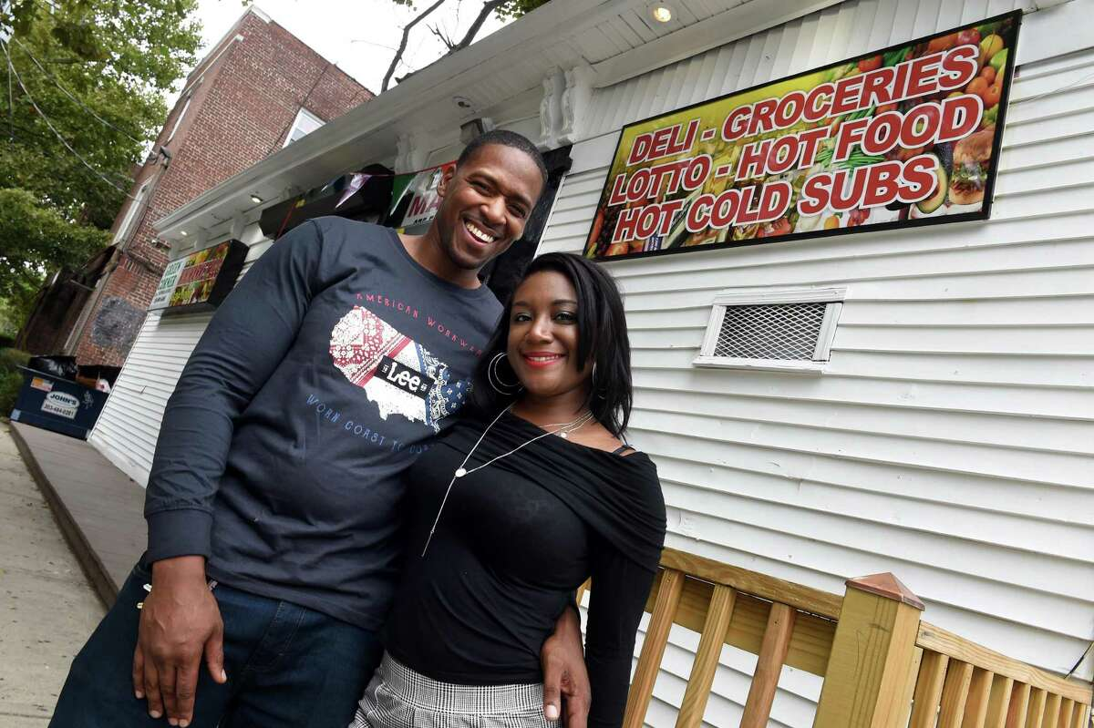Michael Massey with his fiancee, Kenia Lowery, in front of their business, the Black Corner store, on Edgewood Avenue in New Haven Sept. 17, 2021.