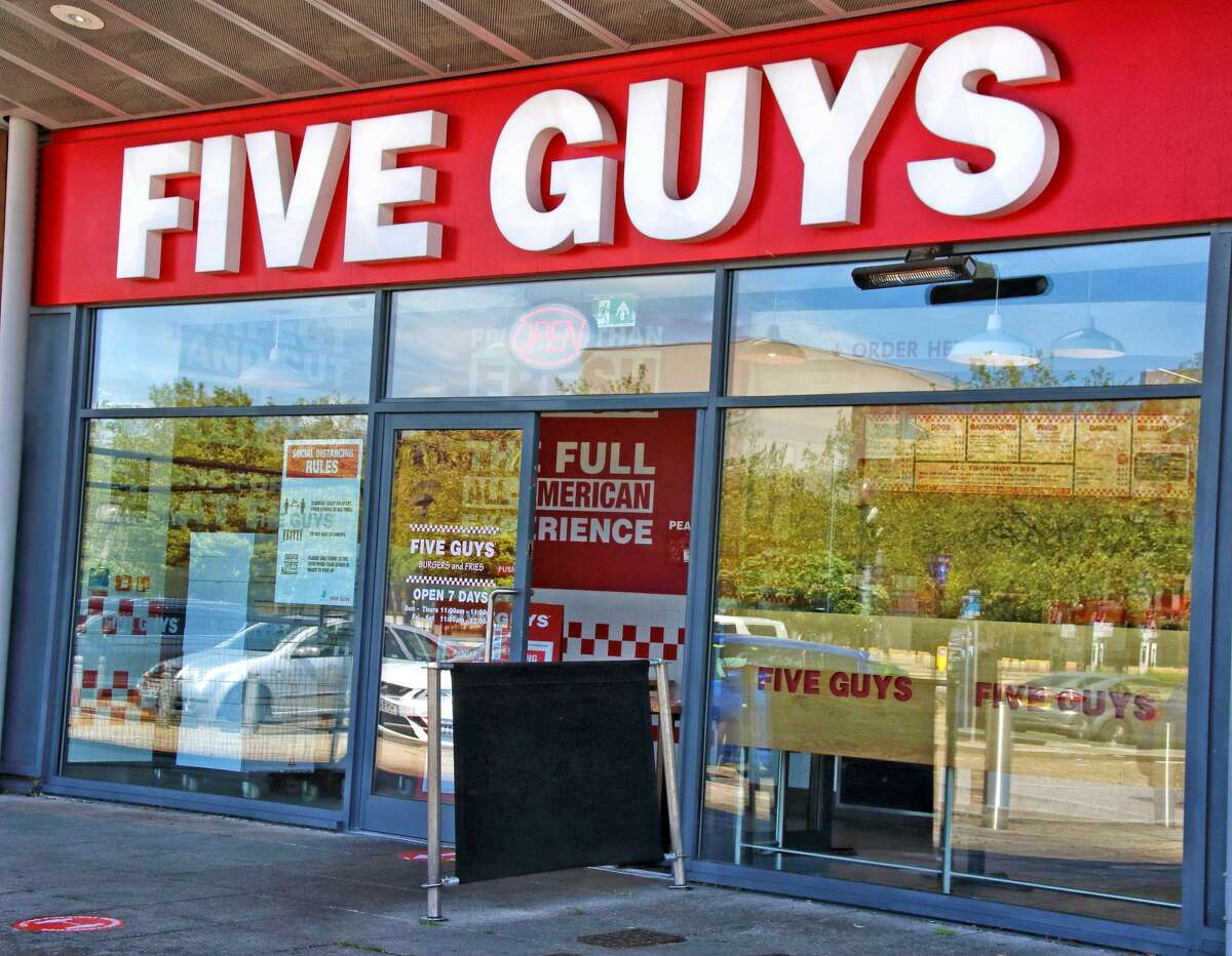 Five Guys burger logo seen at one of their branches in the U.K. (Photo by Keith Mayhew/SOPA Images/LightRocket via Getty Images)