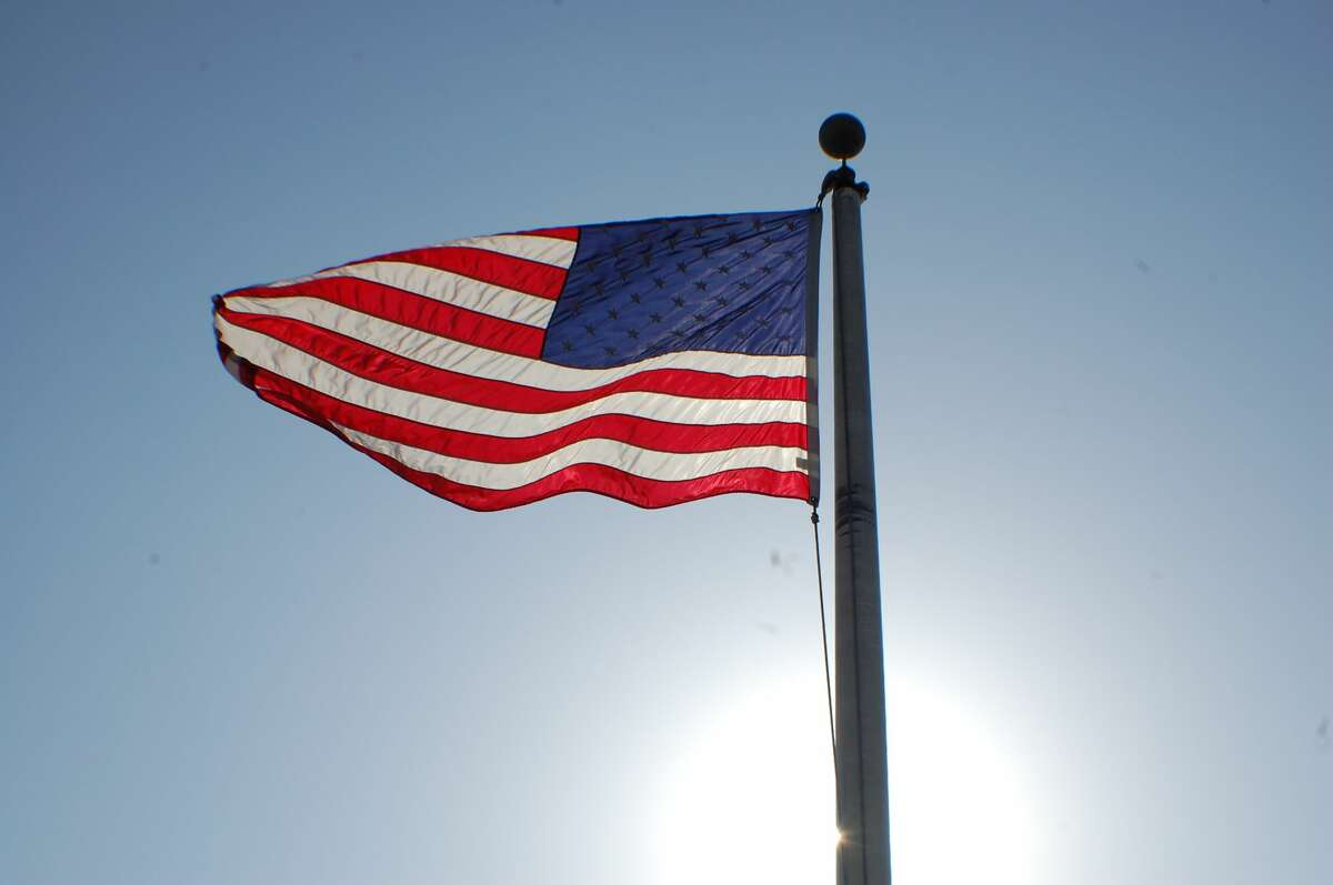 The US flag flies high on a bright, sunny day aboard the Spirt of Peoria riverboat.
