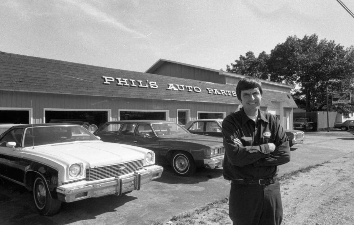 Phil Harliss stands outside his business, Phil's Auto Parts in September 1981. (Manistee County Historical Museum photo)