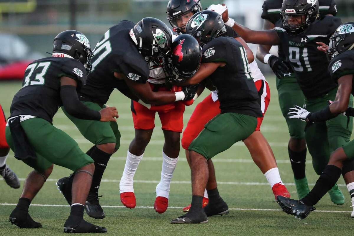 Westfield running back Taji Atkins (21) is stopped by a host of Hightower defenders during the first half of a non-district high school football game at Hall Stadium Friday, Sept. 3, 2021 in Missouri City.