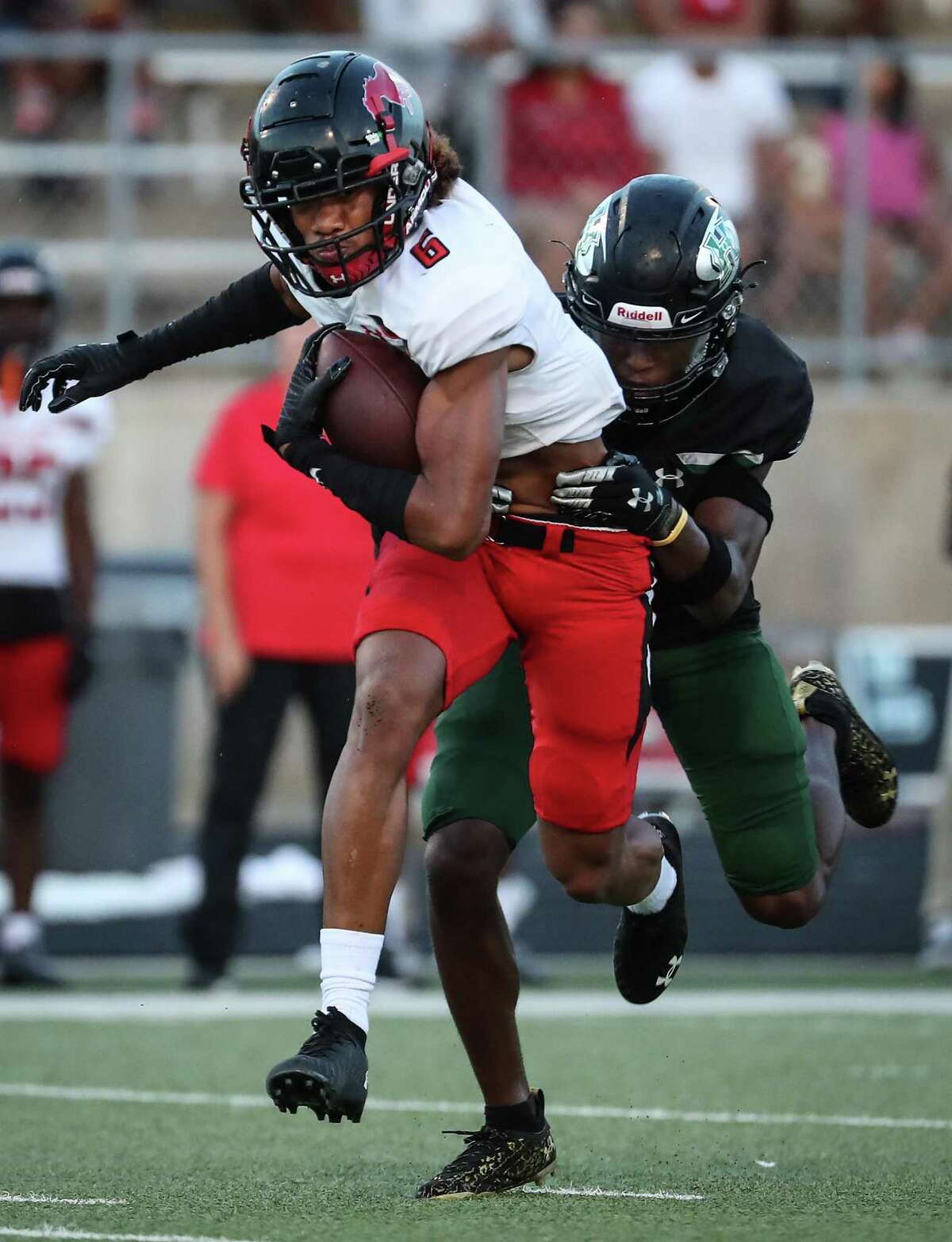 Westfield wide receiver Chuuky Hines (6) makes a first down reception against Hightower defensive back Santana Wilson during the first half of a non-district high school football game at Hall Stadium Friday, Sept. 3, 2021 in Missouri City.