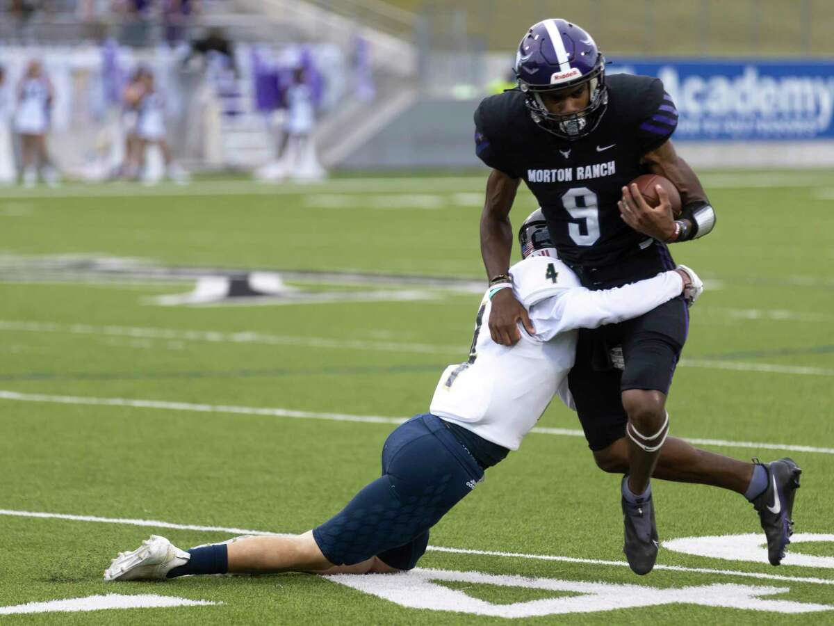 Lake Creek center Austin Goldsby (4) latches onto Morton Ranch quarterback Josh Johnson (9) during the first quarter of a a non-district football game at Legacy Stadium, Thursday, Sept. 16, 2021, in Katy.