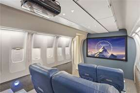 A one-of-kind media room has actual Delta airplane seats.