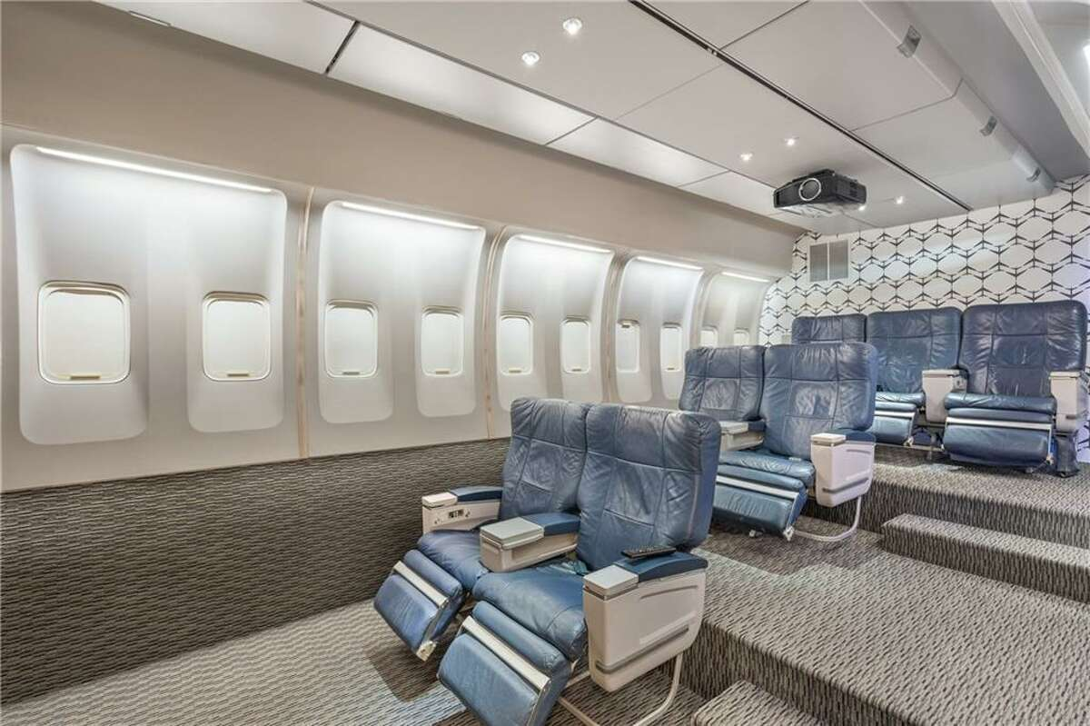 The one-of-a-kind media room is modeled after an airplane cabin.