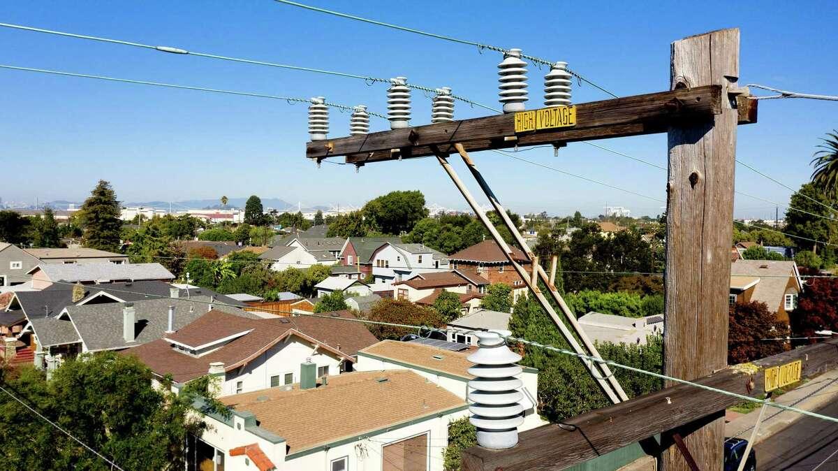 Power lines hang over a neighborhood in Alameda.