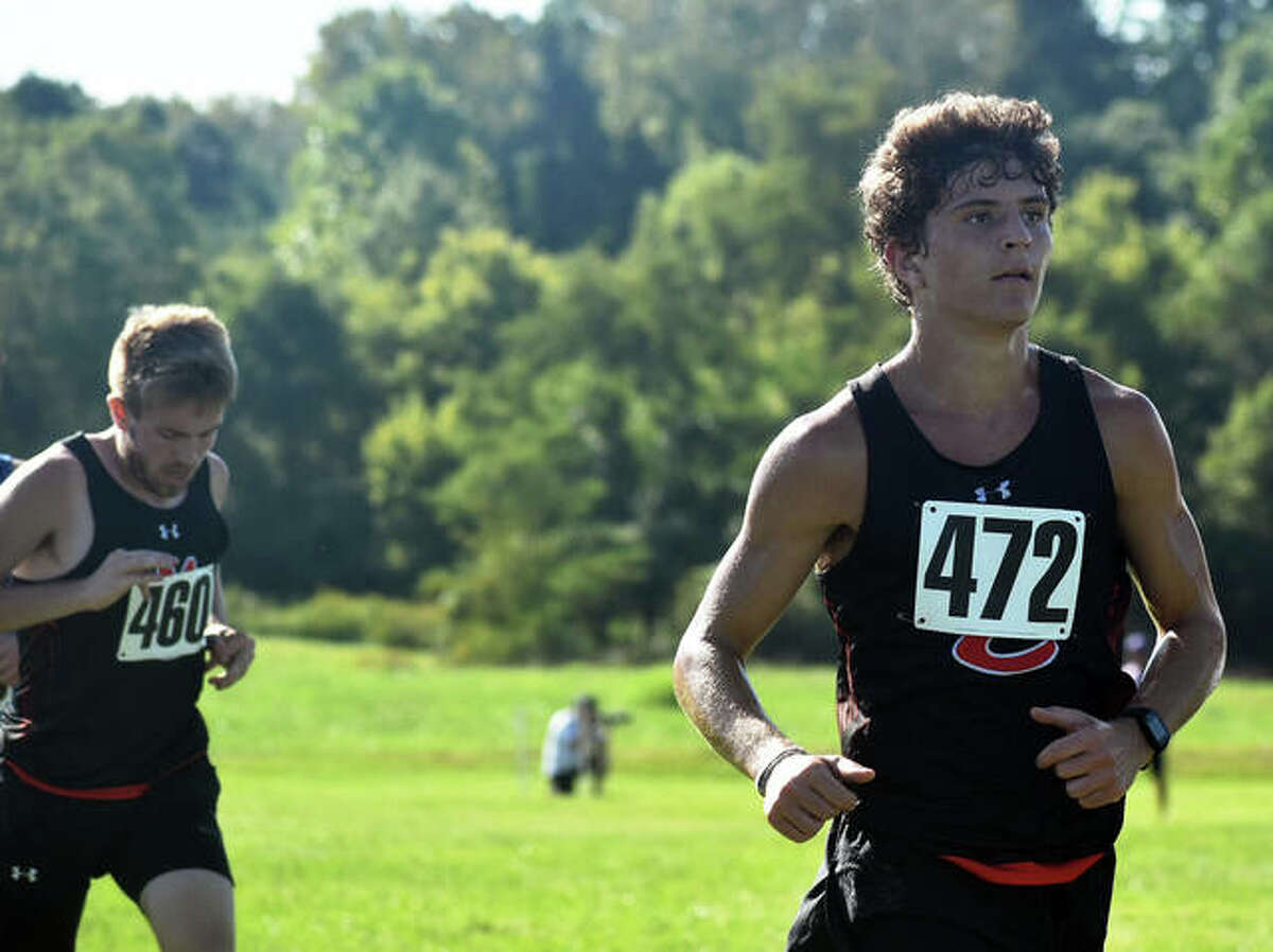 Edwardsville's Ryan Luitjohan, right, paces Jacob Grandone through the first mile of the Edwardsville Invitational on Saturday at SIUE.