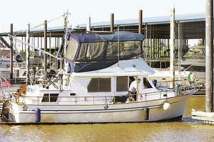 A man washes his boat last week at the Alton Marina where the boating season is winding down.