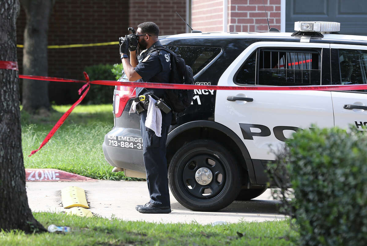 Police investigate a shooting Timber Ridge Apartments where a police officer and the suspect were killed in Houston on Monday, Sept. 20, 2021.