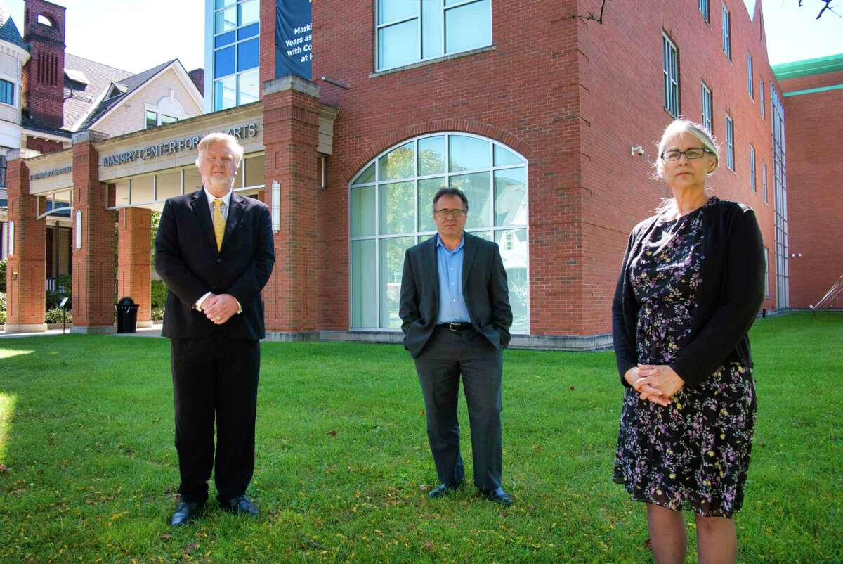 College of Saint Rose tenured music faculty members, Bob Hansbrough, left, Bruce Roter, center, and Yvonne Chavez Hansbrough, pose outside the Massry Center for the Arts building at the college on Monday, Sept. 20, 2021, in Albany, N.Y. They are suing the college after the school's music department was eliminating - causing them to lose their jobs.