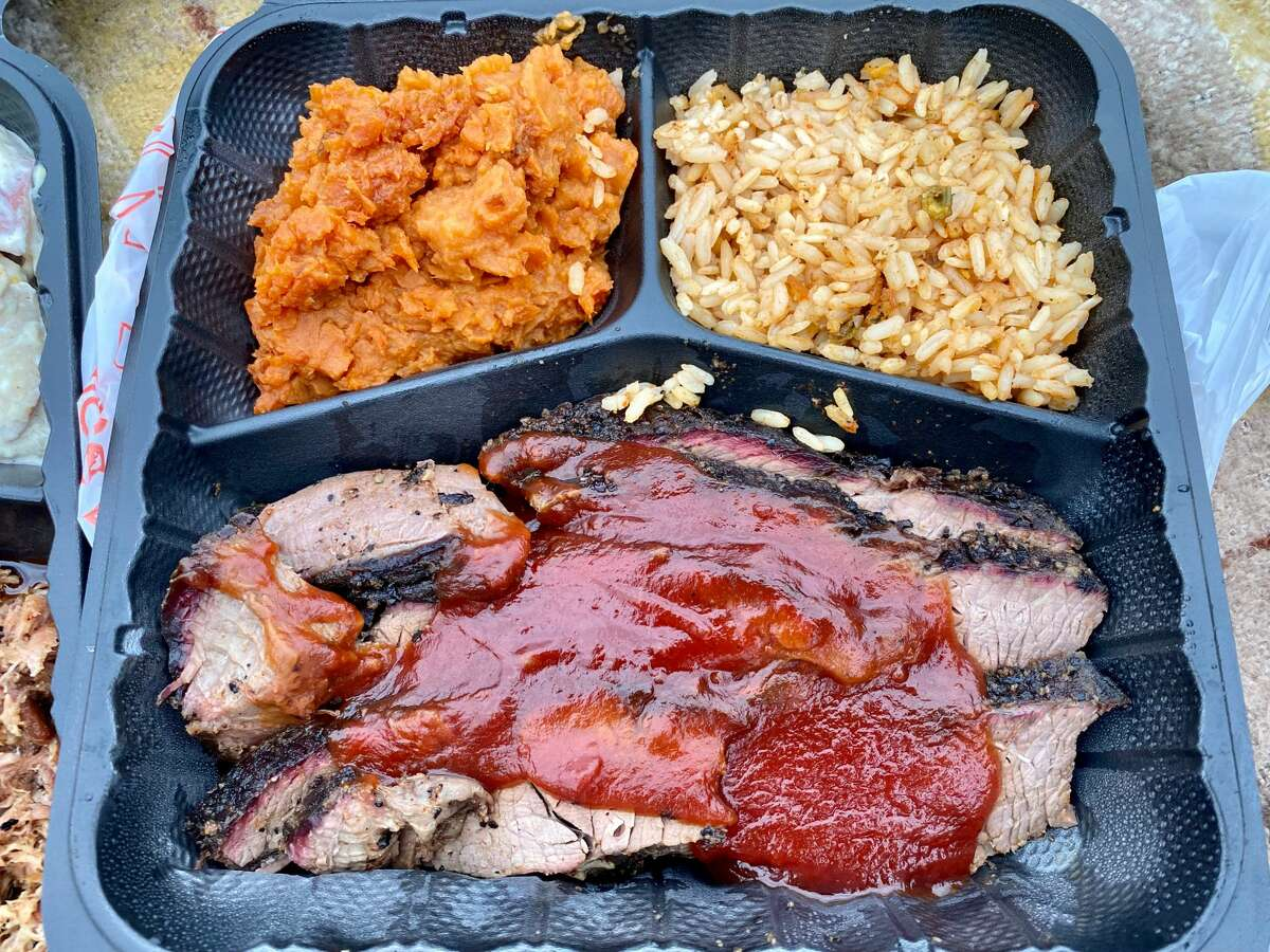Iron Works Grill, its signature brisket shown with sides of sweet potato and smoked rice, is a collaboration of the brothers Howard Gross, a competitive barbecue pitmaster from Delmar, and his brother Keith, who moved from Florida last year.