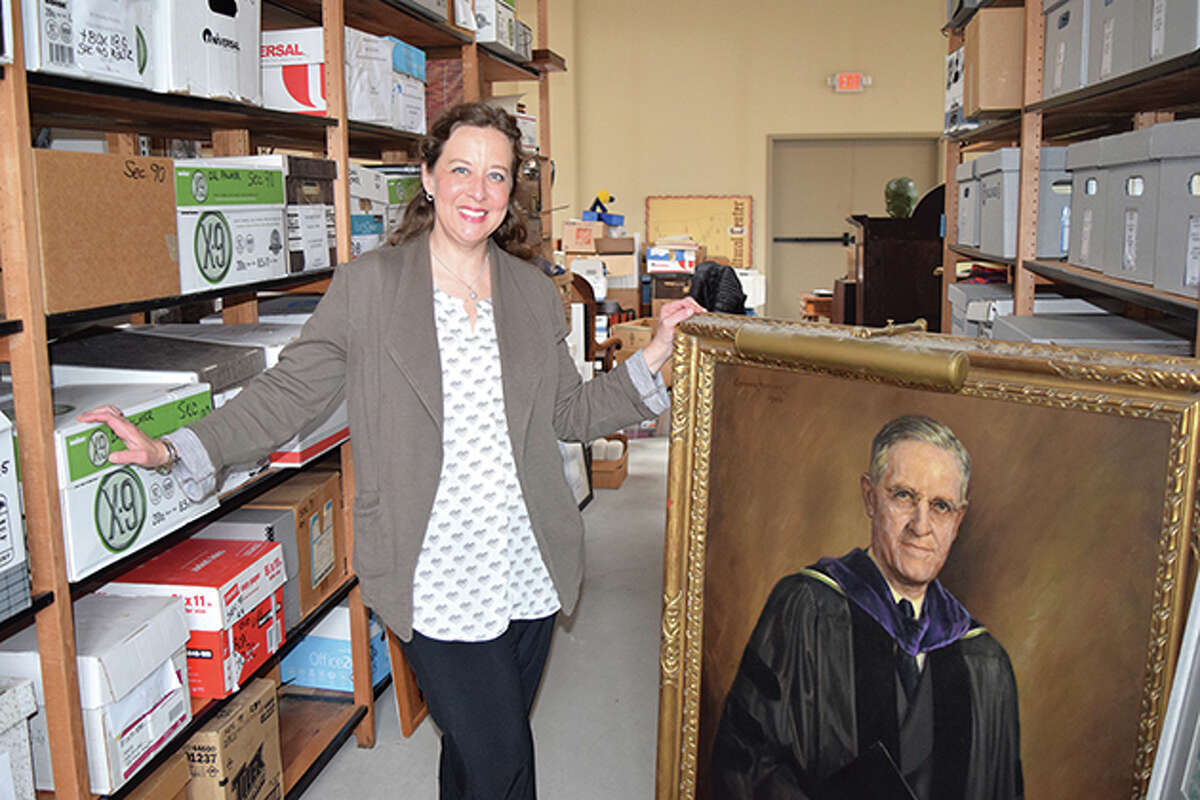 Tiffany Warmowski of Jacksonville, chair of MacMurray Foundation & Alumni Association's History and Museum Committee, shows some of the college memorabilia being featured in future exhibits at the Jacksonville Area Museum.