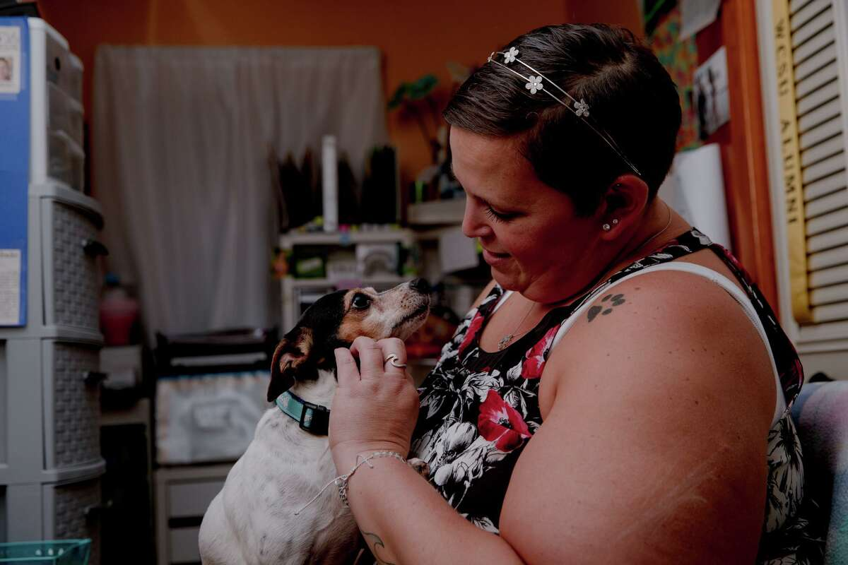 """Kristina Nigro makes an eye contact with her dog Bailee. Being asked to pay back a year after receiving unemployment benefits is frustrating, Nigro said. """"If this happened a month later, then okay, I would have given back how much I would have made in two or three months,"""" she said. """"That's a little more affordable than a whole year and expecting me to pay that back."""""""