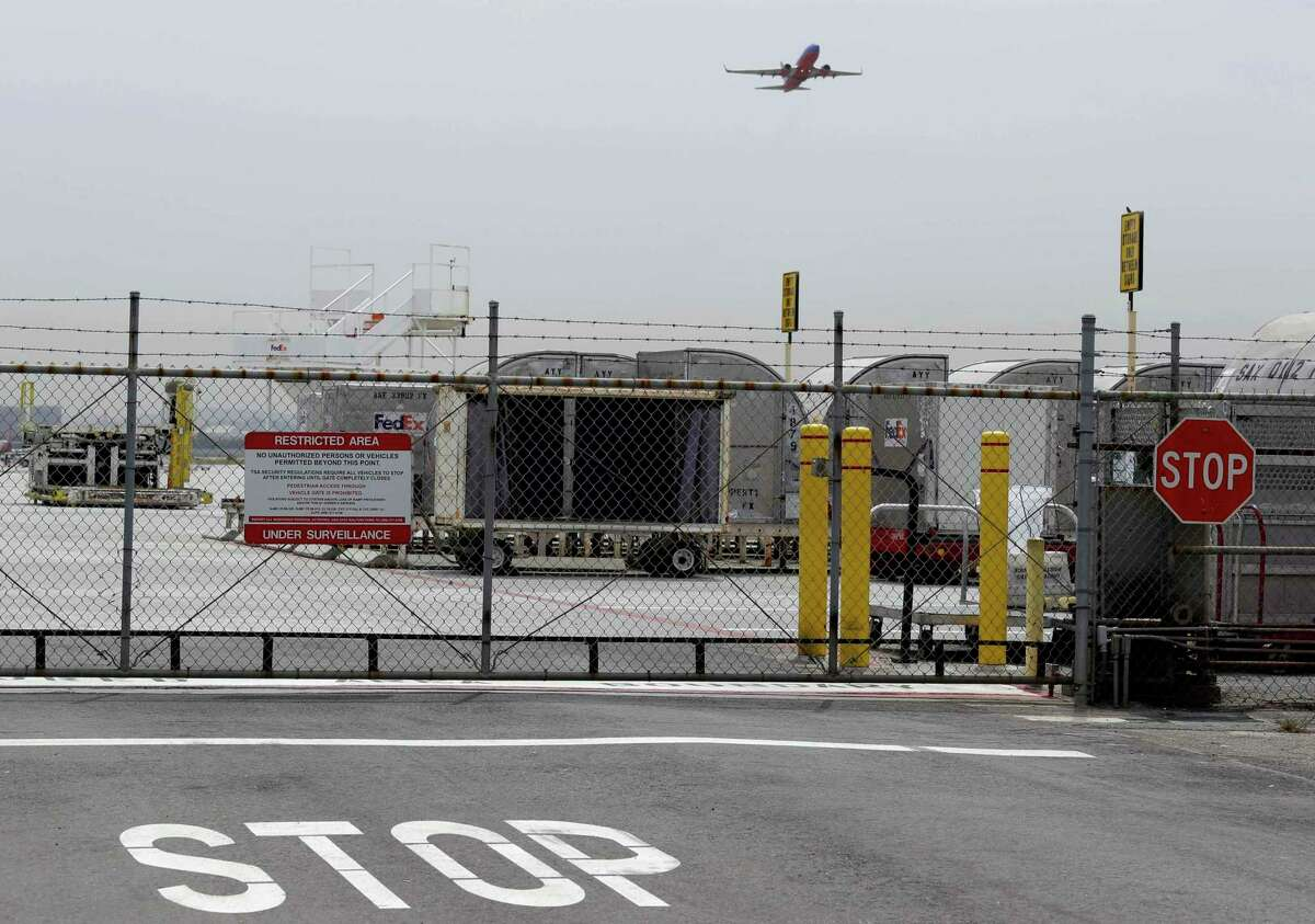 A plane takes off at Mineta San Jose International Airport in 2014. Police said a man experiencing a mental health crisis was arrested Sunday after driving his car into the south end of the airport.