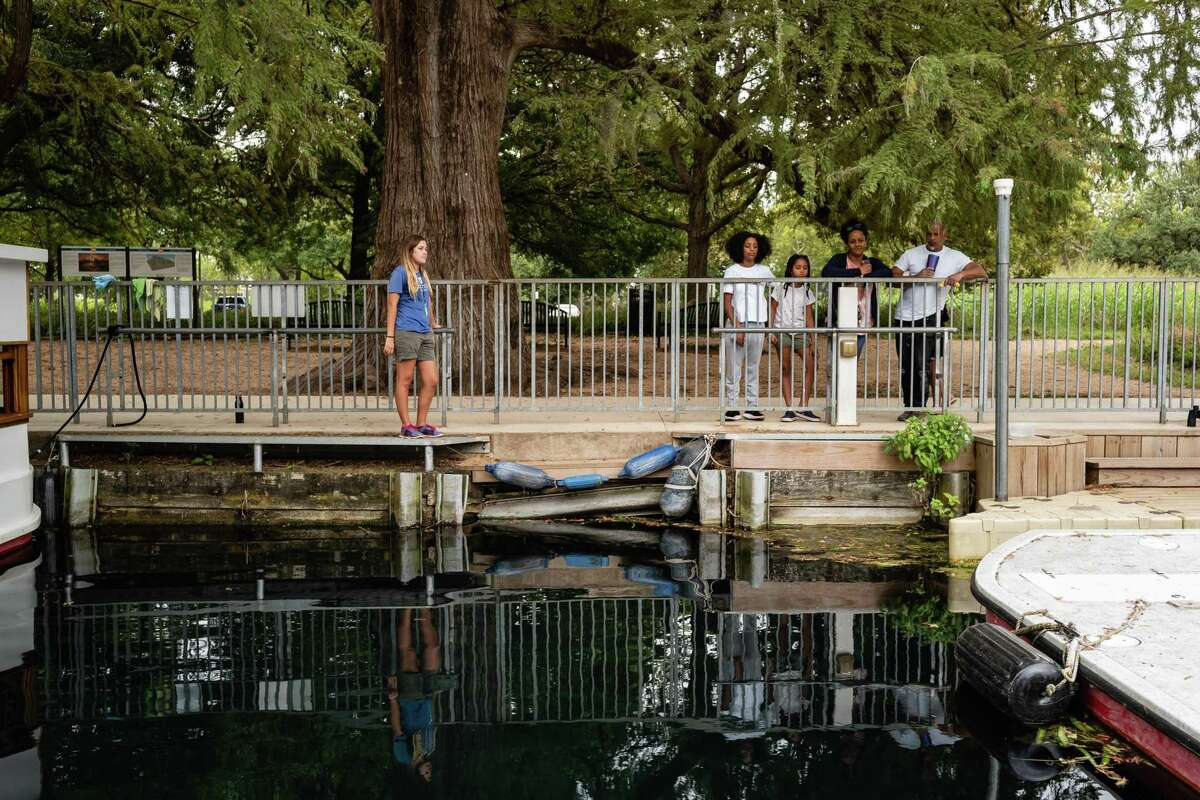 Visitors wait for a boat tour Wednesday on Spring Lake in San Marcos.