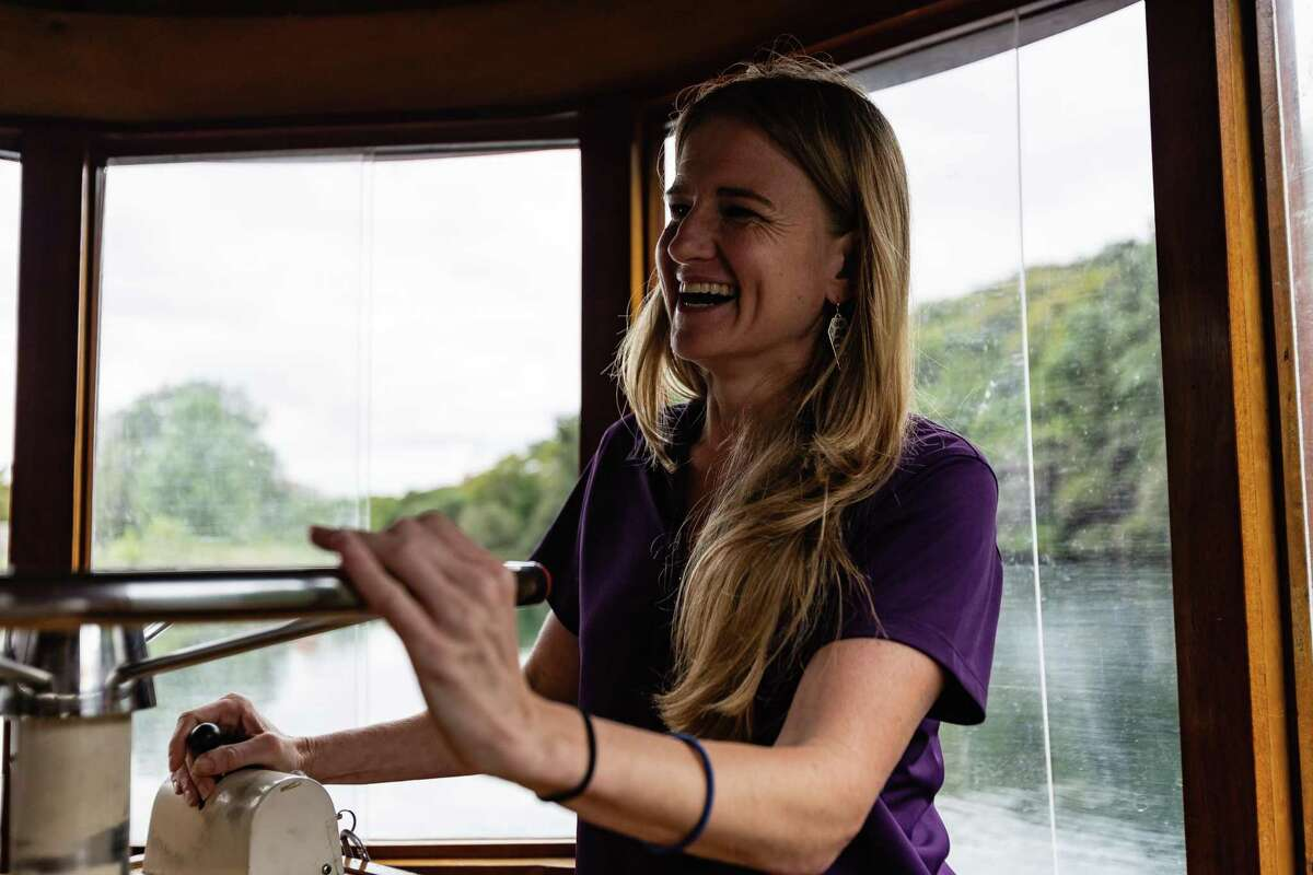 Miranda Wait, deputy director for Spring Lake Operations at Texas State's Meadows Center for Water and the Environment, navigates a glass-bottom boat along Spring Lake on Wednesday in San Marcos.