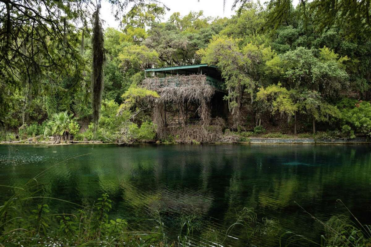 An abandoned structure sits Wednesday at site of the defunct Aquarena Springs Amusement Park at Spring Lake in San Marcos. The area is now Texas State's Meadows Center for Water and the Environment.