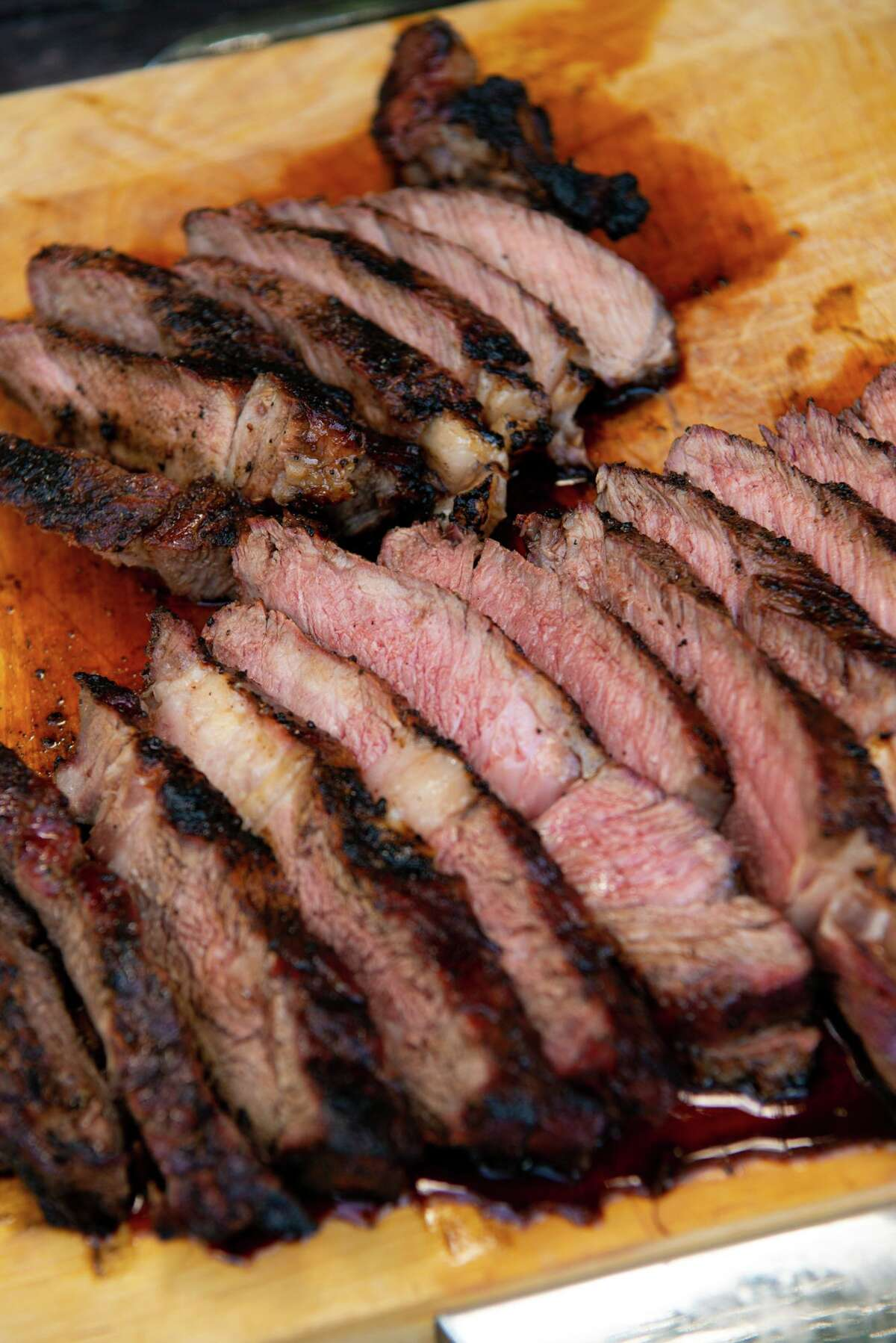Rib-eye steaks of varying thickness were grilled and sliced in Chuck's Food Shack.