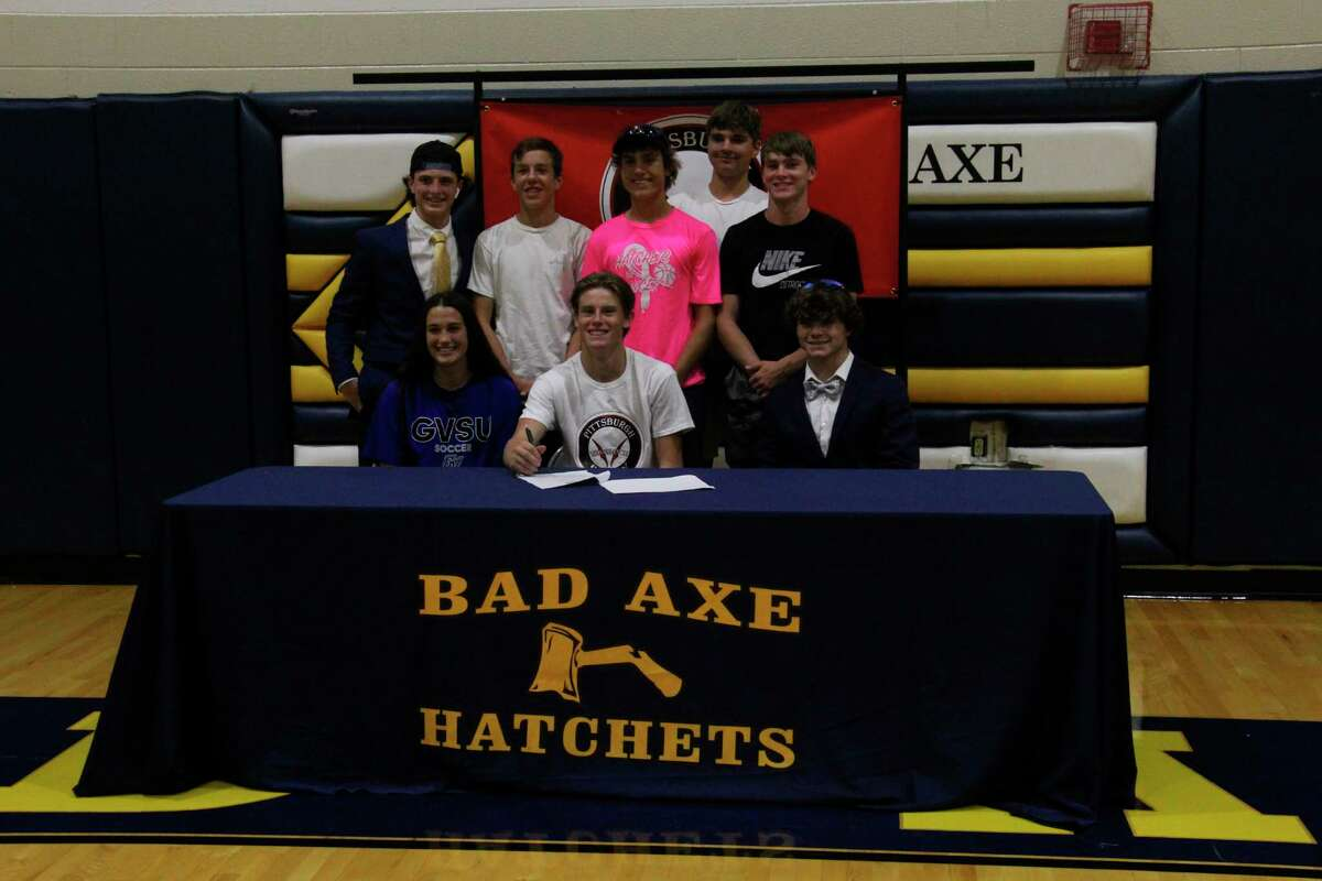 Talaski and friends after signing. (Tom Greene/Huron Daily Tribune)