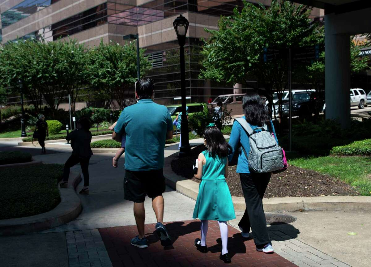 José García and Cristina Hernandez head home after their seven-year-old daughter received her second dose of Pfizer's COVID-19 vaccine Monday, Sept. 20, 2021, at Texas Children's Hospital in Houston. The couple worried about the girl becoming infected with COVID so they enrolled her in a trial of Pfizer's vaccine at Texas Children's Hospital. Their 16-month-old daughter is also in a trial program. On Monday, Pfizer released the initial trial results, showing that its vaccine is safe and effective for the 5-11 age group.