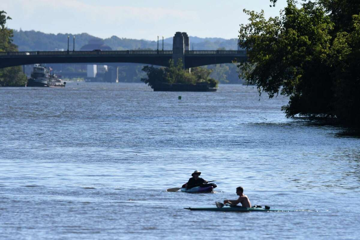 Kayakers paddle up the Hudson River toward the Waterford docks on Monday, Sept. 20, 2021, in Waterford N.Y. Companies that would bring hydropower from Quebec and solar and wind from upstate to New York City have been chosen to build power lines. All or part of the lines would be in the Hudson River.