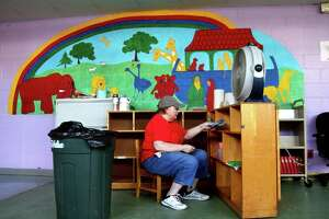 Susan Cassano, a member of St. Paul Lutheran Church, helps with cleanup from the flood damage in the in preschool room inside the church in Byram, Conn., on Saturday September 18, 2021. The church suffered damage due to flooding from Hurricane Ida.