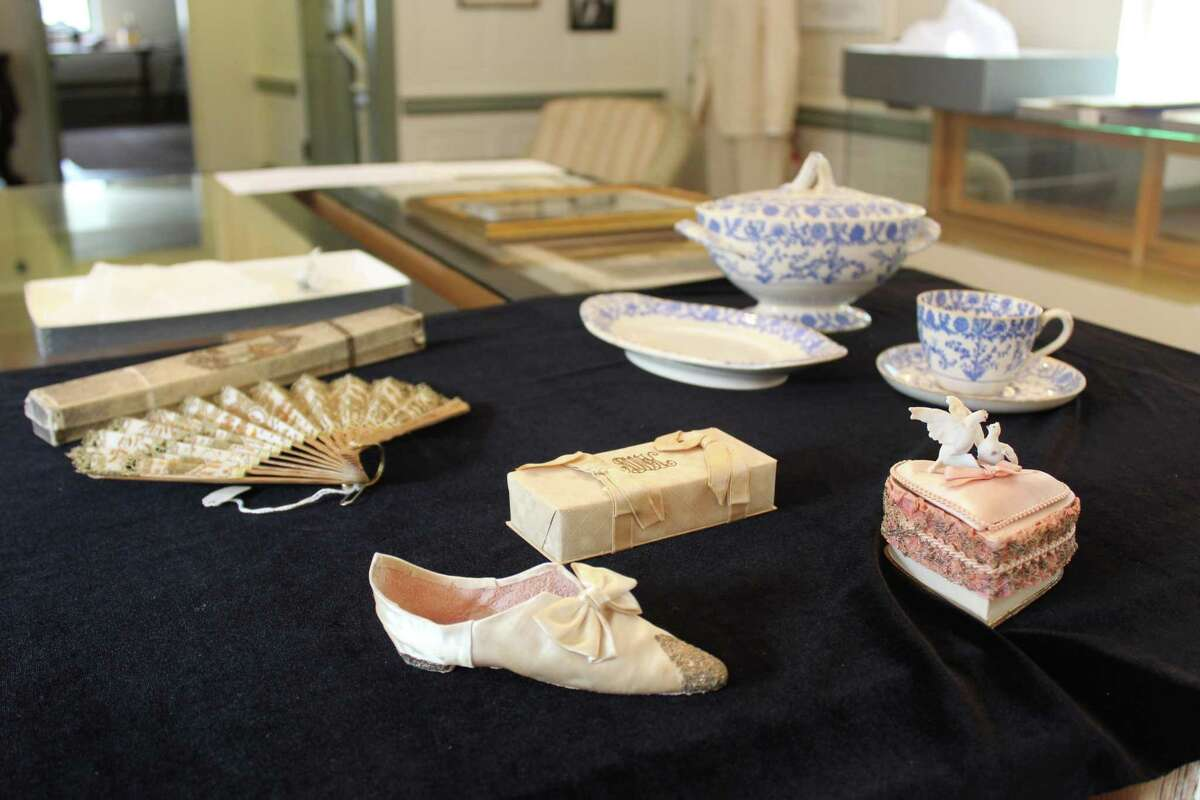 Never-before-seen items from the museum's collections explain how American wedding traditions gained popularity in the 20th century. Pictured (clockwise from left): a fan that belonged to Julia Finch Gilbert; a set of fine china; and assorted wedding favors.