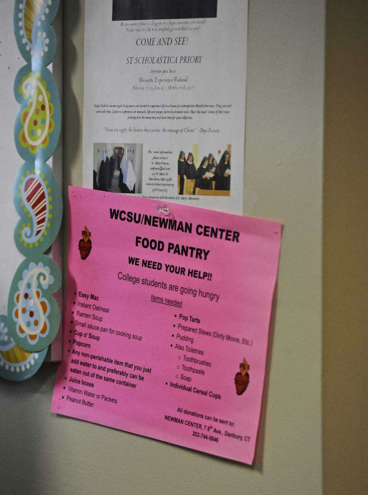 File photo. A sign for the Newman Center Food Pantry at Western Connecticut State University, asking for donations in Danbury, Conn.