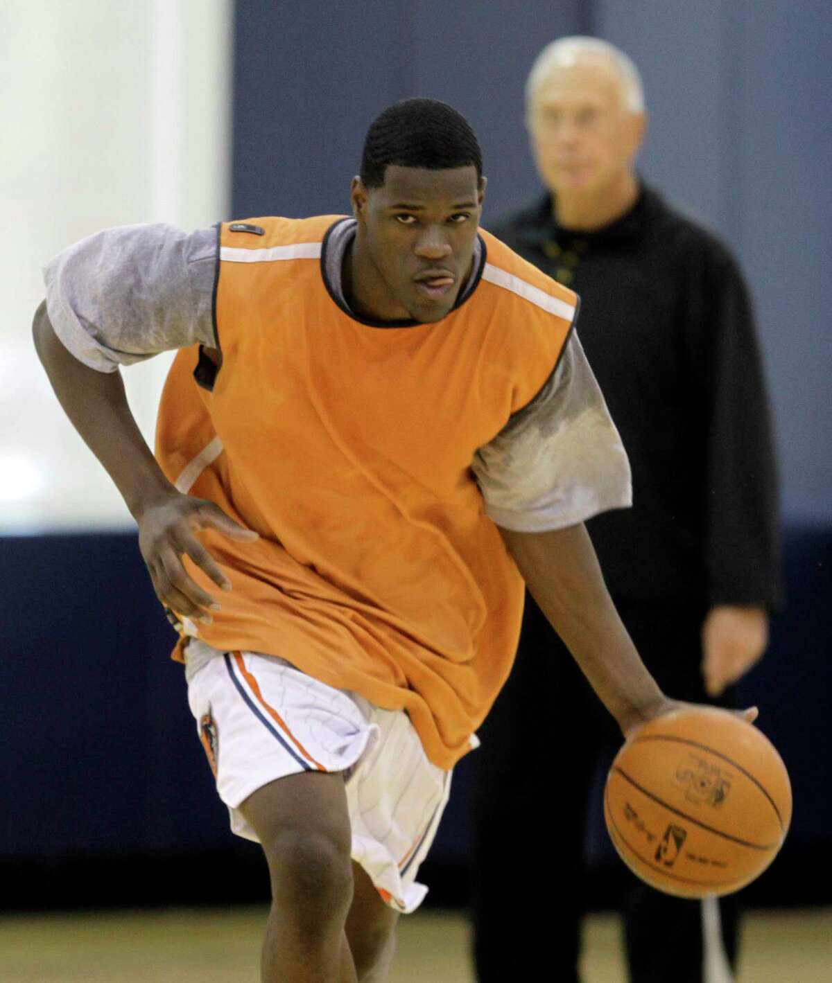 Latavious Williams brings the ball up the court during a pre-NBA draft workout for the Charlotte Bobcats as their coach, Larry Brown, looks on in June 2010. Williams was automatically eligible for the draft after playing the previous season, his first out of high school, in the D League for Tulsa.