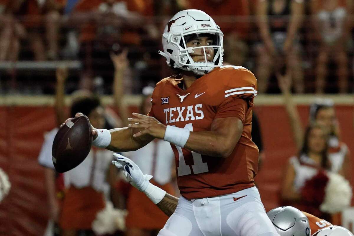 Texas quarterback Casey Thompson (11) looks to pass against Rice during the first half on Sept. 18, 2021, in Austin.