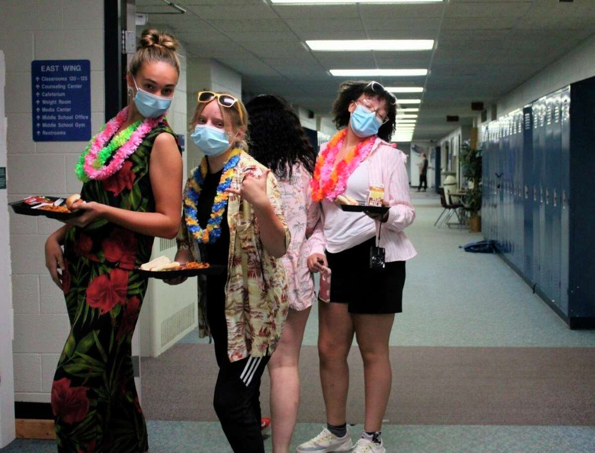 Brethren freshmen Stella Estes, Alice Amstutz and Kennedy Daughty students get into the homecoming spirit by participating in Hawaiian dress-up day on Monday. Brethren students will enjoy a number of activities throughout the week, culminating in a football game and dance on Saturday. (Courtesy photo)