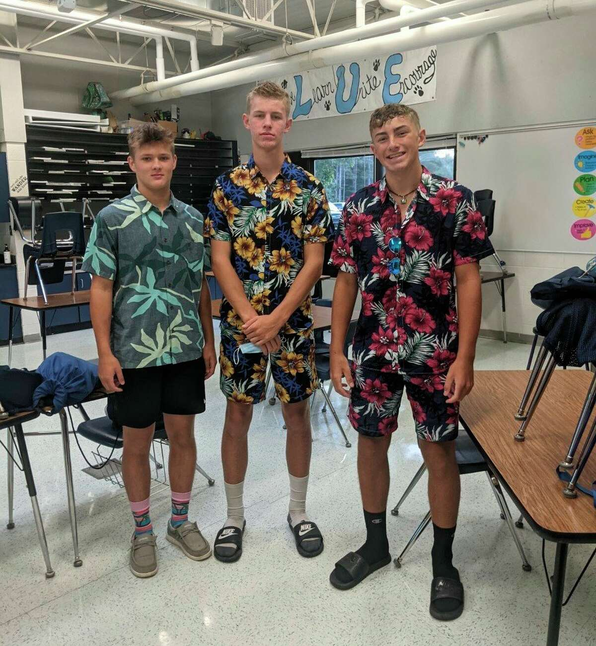 Brethren High School students Jack Meszaros, Garret Mobley and Clayton Mobley pose for a quick photo on Hawaiian Day on Monday. (Courtesy photo)