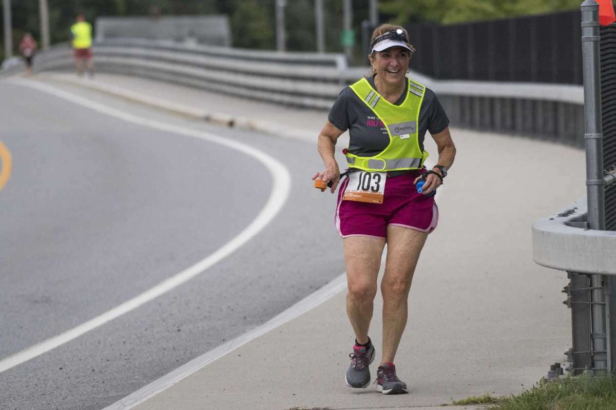 Television personality Benita Zahn is all smiles as she crosses over Saratoga Lake bridge finishing her leg of the Ragnar Relay in the early stages of the 200 mile relay race file photo from 2018 in Saratoga Springs, New York
