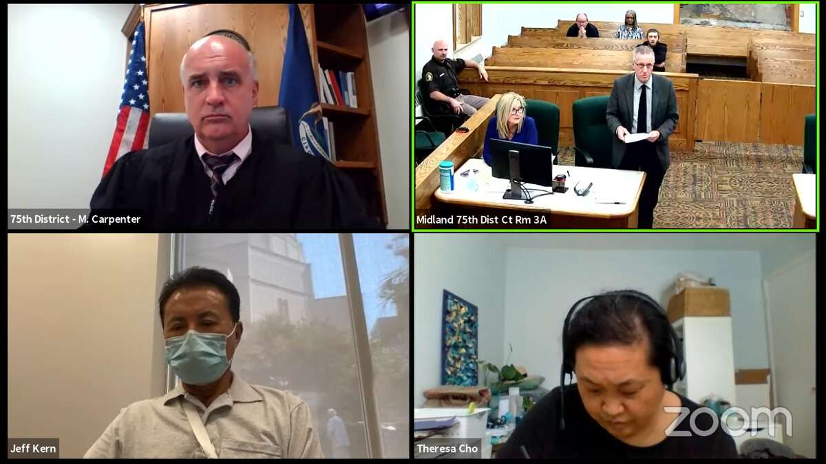 Clockwise from top left: Judge Michael Carpenter of the 75th District Court, City Attorney Jim Branson, interpreter Theresa Cho, and Jeff Kern, owner of the former Holiday Inn. This was a hearing regarding the condemned old Holiday Inn and its demolition progress.