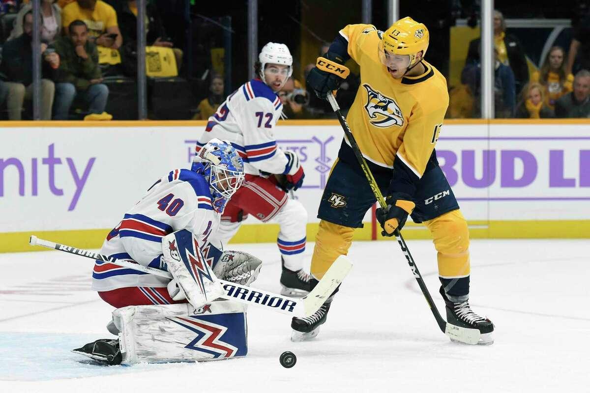 New York Rangers goaltender Alexandar Georgiev (40) stops a shot as Nashville Predators center Nick Bonino (13) looks for the rebound during the second period of an NHL hockey game Saturday, Nov. 2, 2019, in Nashville, Tenn. (AP Photo/Mark Zaleski)