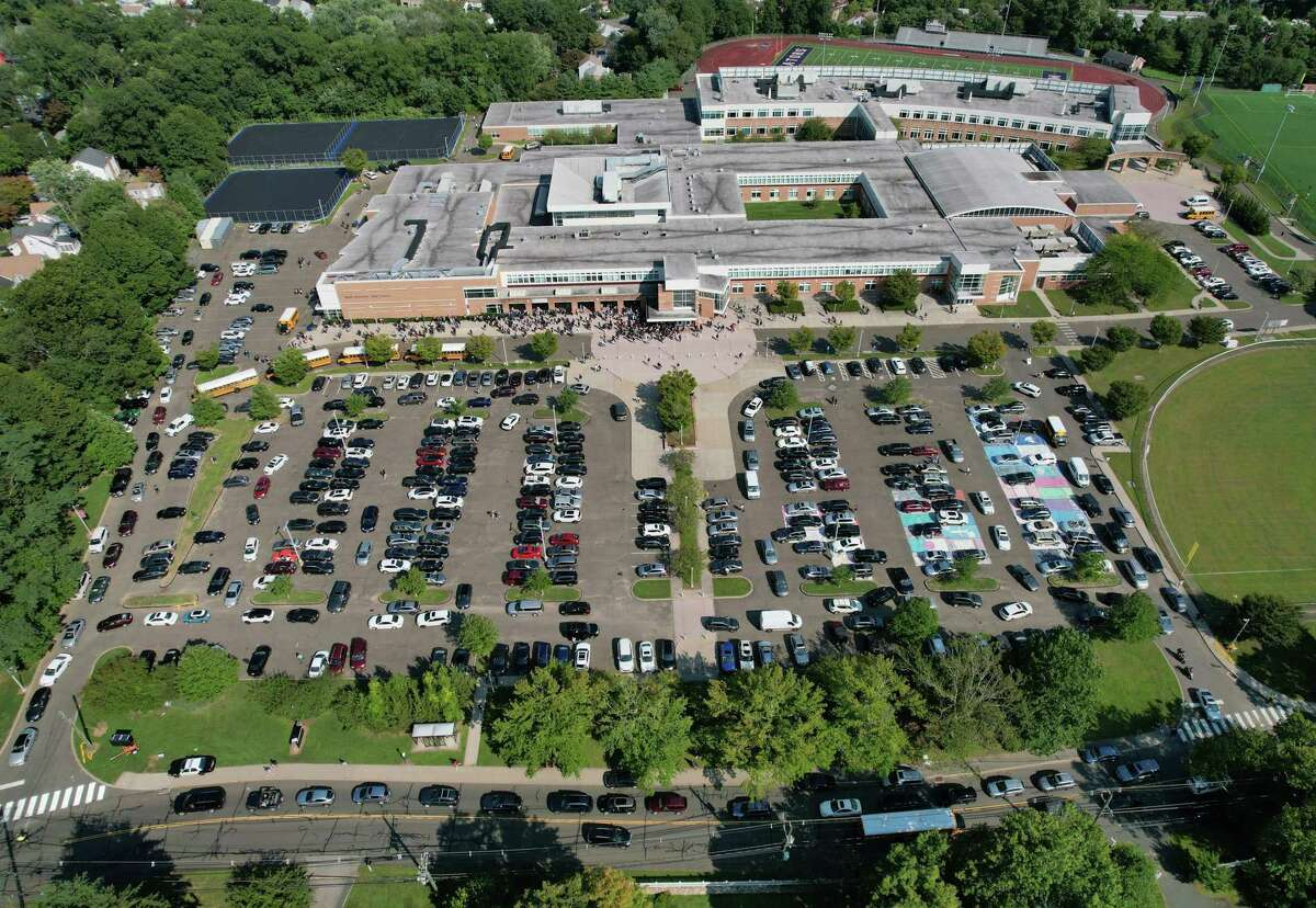 Traffic is backed up as buses pick up students during dismissal at Brien McMahon High School in Norwalk, Conn. Monday, Sept. 13, 2021. Since students returned to school, traffic at arrival and dismissal has caused significant backups in the area.