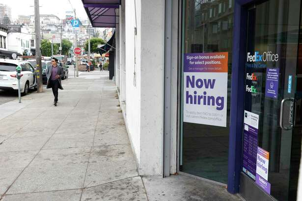 SAN FRANCISCO, CALIFORNIA - SEPTEMBER 16: A now hiring sign is posted in the window of FedEx Office store on September 16, 2021 in San Francisco, California. Unemployment claims inched up to 332,000 from a pandemic low of 312,000 a week before. (Photo by Justin Sullivan/Getty Images)