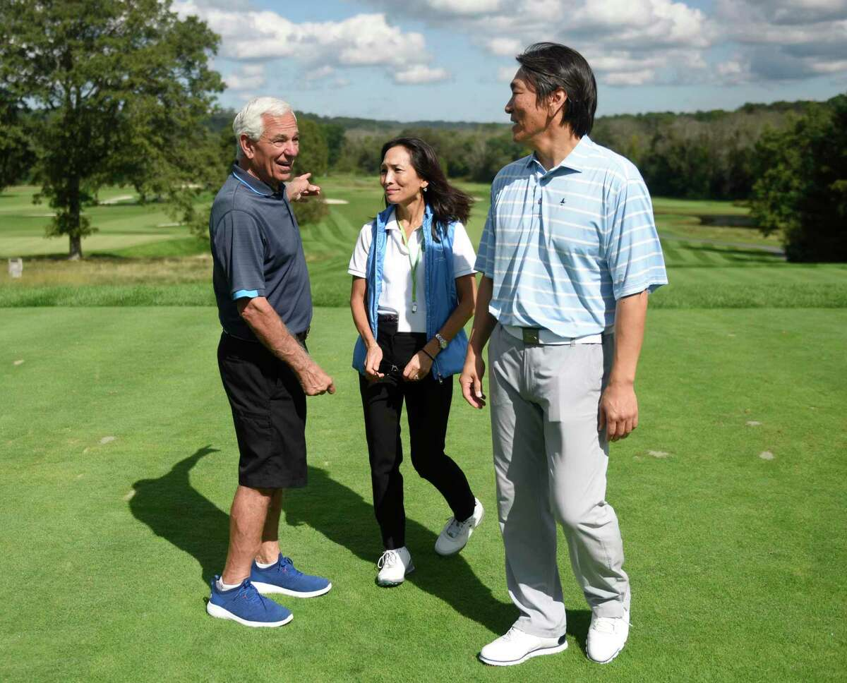 Former baseball manager and current Stamford mayoral candidate Bobby Valentine, left, Global Citizens Initiative Founder and President Yumi Kuwana, center, and former New York Yankees baseball player Hideki Matsui chat at the Champion a Champion Golf Classic at Tamarack Country Club in Greenwich, Conn. Monday, Sept. 20, 2021. The celebrity golf outing was a joint fundraiser between Greenwich-based non-profit Global Citizens Initiative and Hideki Matsui's non-profit Matsui 55 Baseball Foundation.