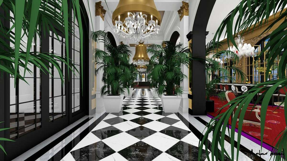 """A grand hallway called """"Peacock Alley"""" lost in renovations decades ago, is being restored in renovations at the Grand Galvez since being purchased by Dallas-based Seawall Hospitality this year. The bell chandeliers are inspired by the work of French designer Philippe Starck."""