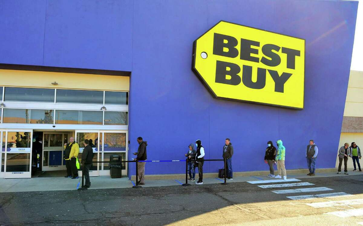 Customers wait in line to be let into Best Buy at Hawley Lane Mall in Trumbull March 21, 2020.