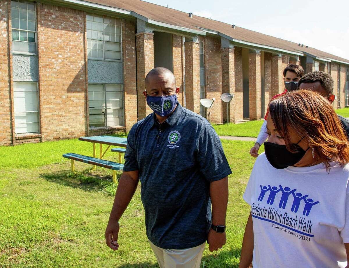 Houston ISD superintendent Millard House II, center, visited students who had stopped attending school at their homes, during the annual Students Within Reach Walk on Saturday, Sept. 18, 2021, in Houston.