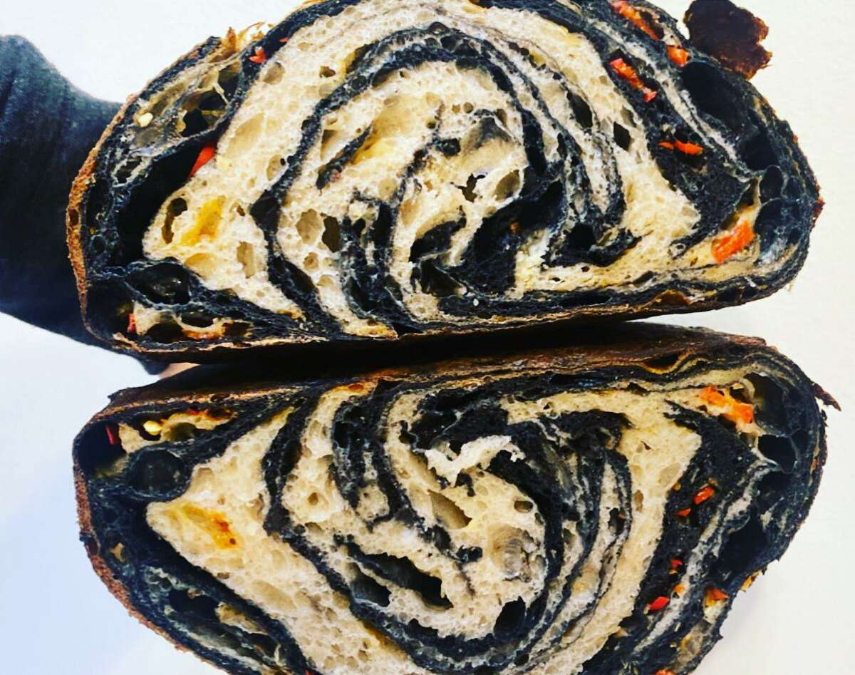Squid ink bread is swirled with cheese and chiles from Automat, the upcoming San Francisco restaurant from Matthew Kirk.