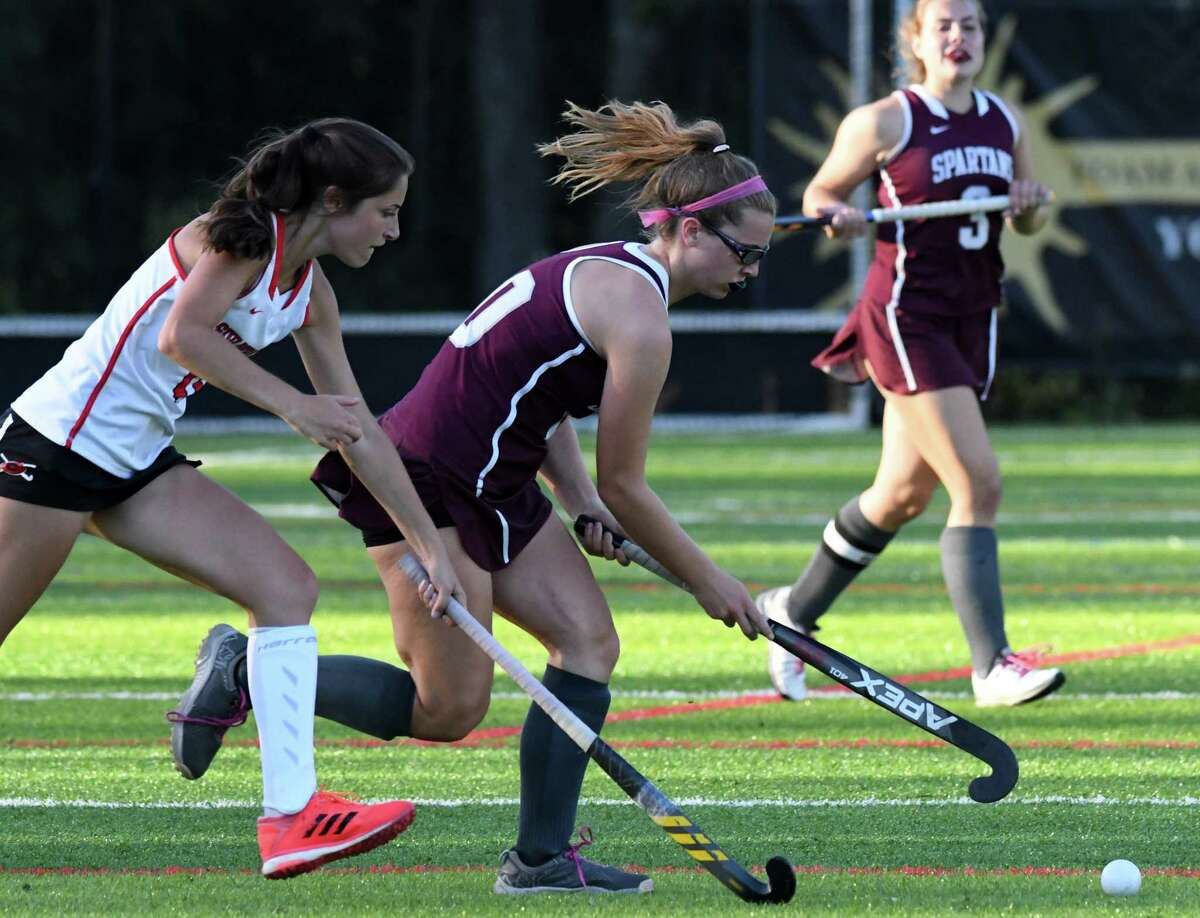 Maggie Holmes of Burnt Hills-Ballston Lake, center, attacks against Guilderland?•s Victoria Cusato, left, during a field hockey game on Monday evening, Sept. 20, 2021, at Afirm's Sports Park in Colonie, N.Y.
