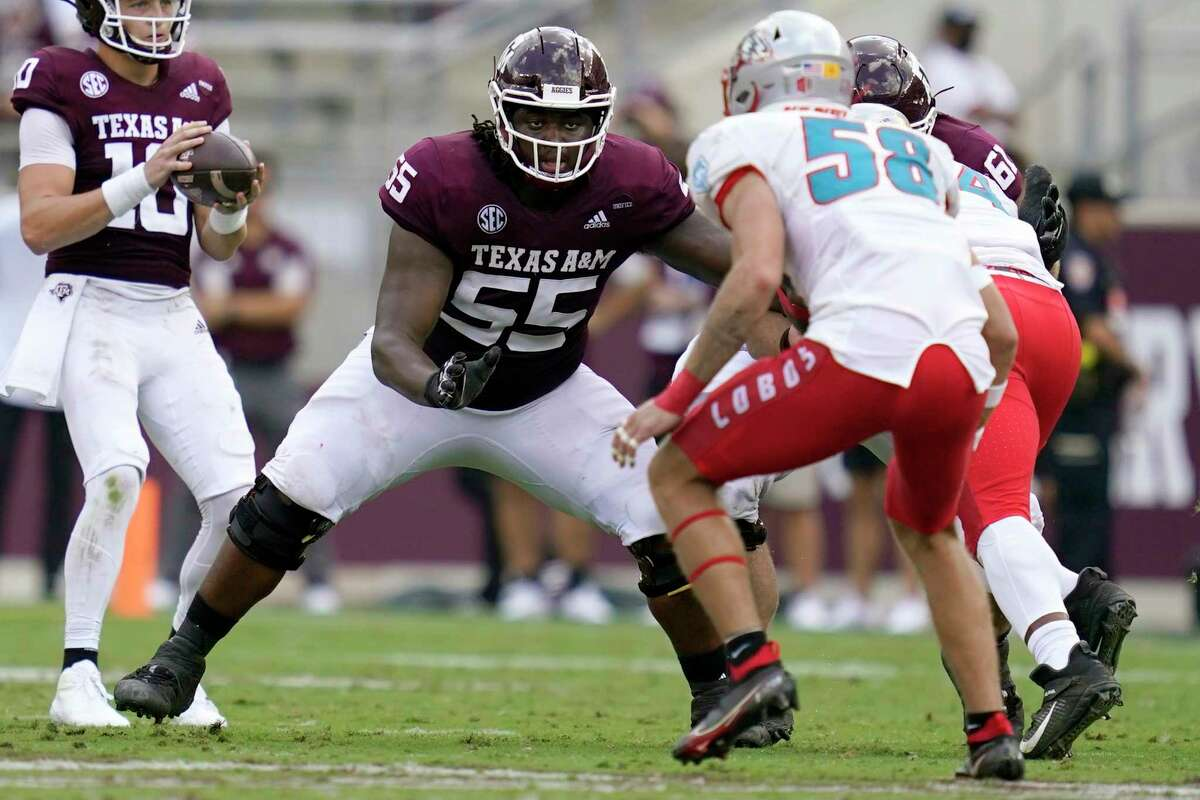 Kenyon Green (55), a junior All-American tackle, is the versatile leader of a mostly inexperienced Texas A&M offensive line that has been struggling with consistent blocking in the run game.