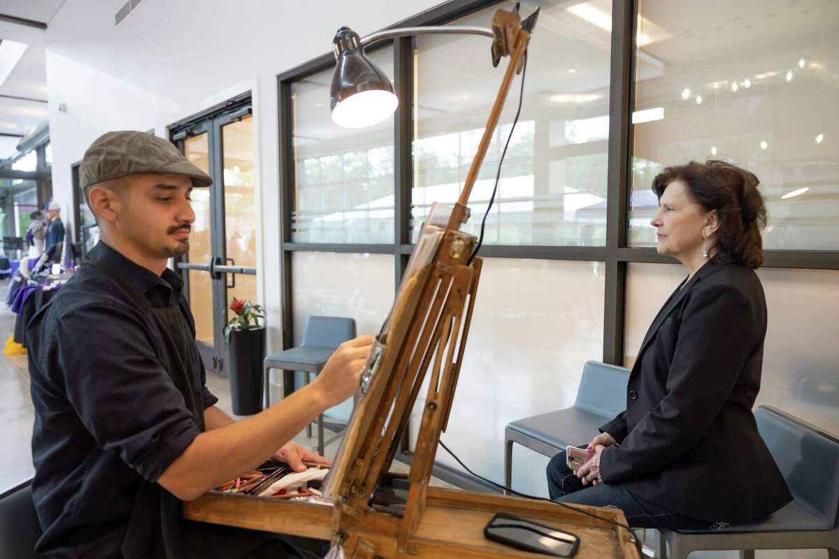 Mac Garcia, a caricature artist, draws during a celebration of Willis ISD's 115th Birthday hosted by the Willis ISD Education Foundation, Saturday, Sept. 18, 2021, in Willis.