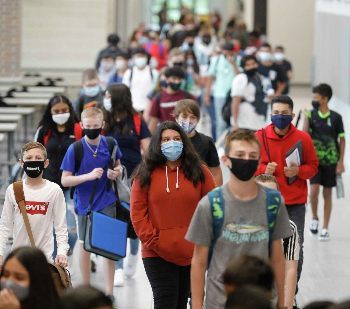 Students wear face masks while walking the hallways of Stockton Junior High School when the school first opened. Last week, a letter was sent to Stockton parents warning them about a new TikTok trend that challenges students to steal school property and post a video of their theft on the video app.